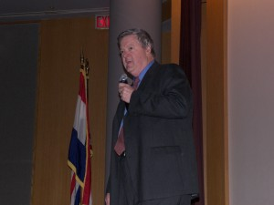 Photograph of Peter Muller speaking at St. Louis meeting.